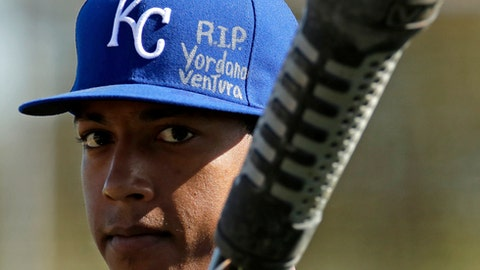 Kansas City Royals' Raul Mondesi wears a tribute to teammate Yordano Ventura, who died in a car accident last month, as he prepares to bat during spring training baseball practice Thursday, Feb. 16, 2017, in Surprise, Ariz. (AP Photo/Charlie Riedel)