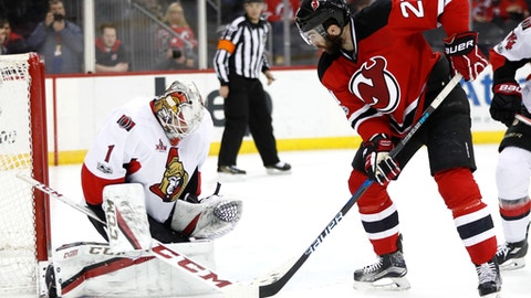 Ottawa Senators goalie Mike Condon (1) stuffs a shot by New Jersey Devils right wing Kyle Palmieri (21) during the second period of an NHL hockey game, Thursday, Feb. 16, 2017, in Newark, N.J. (AP Photo/Julio Cortez)