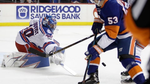 New York Rangers goalie Henrik Lundqvist (30) deflects a shot by New York Islanders' Casey Cizikas (53) during the second period of an NHL hockey game Thursday, Feb. 16, 2017, in New York. (AP Photo/Frank Franklin II)