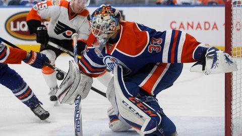 Edmonton Oilers goalie Cam Talbot (33) makes a save against the Philadelphia Flyers during the third period of an NHL hockey game Thursday, Feb. 16, 2017, in Edmonton, Alberta, (Jason Franson/The Canadian Press via AP)