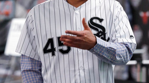 FILE - In this Jan. 27, 2017, file photo, Chicago White Sox pitcher Derek Holland speaks to reporters during a media reception at the baseball team's annual fan convention in Chicago. Pitching for a team other than the Texas Rangers, left-hander Derek Holland hopes to stay healthy enough to help Chicago's rotation this season. (AP Photo/Nam Y. Huh, File)