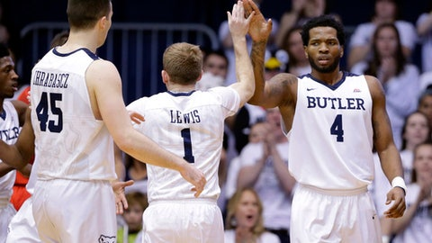 Butler forward Tyler Wideman (4) celebrates a basket with guard Tyler Lewis (1) and forward Andrew Chrabascz (45) in the second half of an NCAA college basketball game against DePaul in Indianapolis, Sunday, Feb. 19, 2017. (AP Photo/Michael Conroy)