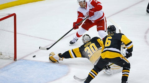 Detroit Red Wings' Nick Jensen (3) gets the puck past Pittsburgh Penguins goalie Matt Murray (30) for a goal in the first period of an NHL hockey game in Pittsburgh, Sunday, Feb. 19, 2017. (AP Photo/Gene J. Puskar)