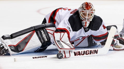 New Jersey Devils goalie Keith Kinkaid (1) makes a save during the second period of an NHL hockey game against the New York Islanders, Sunday, Feb. 19, 2017, in New York. (AP Photo/Kathy Willens)