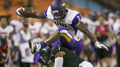 Northern Iowa Panthers running back David Johnson (7) leaps over Hawaii Warriors defensive back Ne'Quan Phillips (1) during the fourth quarter in the NCAA college football game between Northern Iowa against Hawaii, Saturday, Sept. 13, 2014, in Honolulu.  (AP Photo/Marco Garcia)
