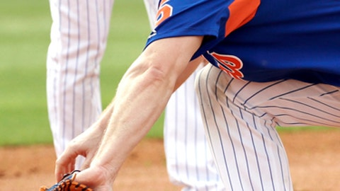 New York Mets third baseman David Wright fields a ground ball during a spring training baseball workout Tuesday, Feb. 21, 2017, in Port St. Lucie, Fla. (AP Photo/David J. Phillip)