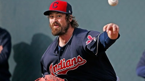 FILE - In this Tuesday, Feb. 14, 2017, file photo, Cleveland Indians pitcher Andrew Miller throws a pitch at the Indians baseball spring training facility in Goodyear, Ariz. The left-hander, who makes his living fooling hitters and whose ability to pitch extended innings in October carried Cleveland to within one victory of a World Series title last season, will leave spring training March 2017 to play for Team USA in the World Baseball Classic. (AP Photo/Ross D. Franklin, File)