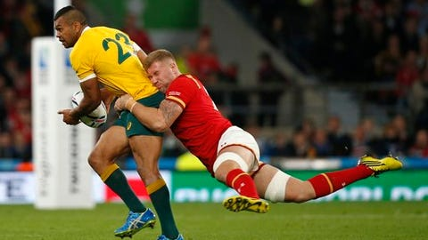 FILE - In this Saturday, Oct. 10, 2015 file photo, Australia's Kurtley Beale, left, is tackled by Wales' Ross Moriarty during their Rugby World Cup Pool A match at Twickenham stadium in London.  For the second match in a row, Ross Moriarty starts for Wales and Taulupe Faletau is in the reserves for the Six Nations game on Saturday, Feb. 25, 2017 against Scotland at Murrayfield. (AP Photo/Alastair Grant, file)