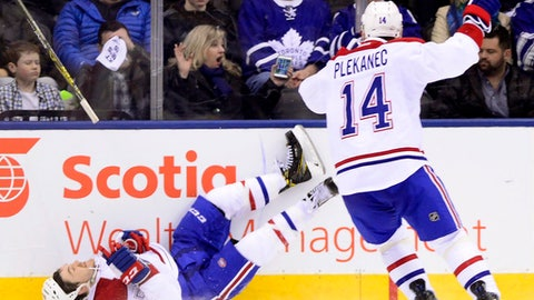 Montreal Canadiens' Andrew Shaw (65) reacts after scoring the game-winning overtime goal as Tomas Plekanec (14) skates by following an NHL hockey game against the Toronto Maple Leafs, in Toronto on Saturday, Feb. 25, 2017. (Frank Gunn/The Canadian Press via AP)