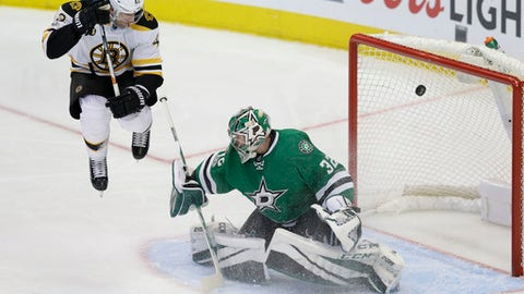 Boston Bruins right wing David Backes (42) jumps out of the way of his teammate Patrice Bergeron's shot allowing a goal against Dallas Stars goalie Kari Lehtonen (32) during the third period of an NHL hockey game in Dallas, Sunday, Feb. 26, 2017. The Bruins won 6-3. (AP Photo/LM Otero)