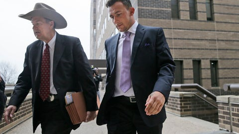 Former NFL quarterback Johnny Manziel, right, walks with his lawyer Jim Darnell after a court hearing in Dallas, Tuesday, Feb. 28, 2017. A Dallas County judge ordered Manziel to be at the hearing to address concerned about reports that he has violated terms of a plea agreement for a domestic violence case. (AP Photo/LM Otero)