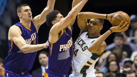 Mar 26, 2016; Milwaukee, WI, USA; Milwaukee Bucks forward Giannis Antetokounmpo (34) looks to pass the ball as Phoenix Suns guard Devin Booker (1) and center Alex Len (21) defend during the fourth quarter at BMO Harris Bradley Center.  Milwaukee won 105-94.  Mandatory Credit: Jeff Hanisch-USA TODAY Sports
