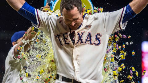 May 14, 2016; Arlington, TX, USA; Texas Rangers left fielder Drew Stubbs (15) is doused with water and Powerade and bubble gum after hitting a walk off home run against the Toronto Blue Jays during the tenth inning at Globe Life Park in Arlington. The Rangers defeat the Blue Jays 6-5 in extra innings. Mandatory Credit: Jerome Miron-USA TODAY Sports