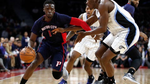 Dec 4, 2016; Auburn Hills, MI, USA; Detroit Pistons guard Reggie Jackson (1) dribbles the ball against Orlando Magic center Bismack Biyombo (11) during the fourth quarter at The Palace of Auburn Hills. Magic win 98-92. Mandatory Credit: Raj Mehta-USA TODAY Sports