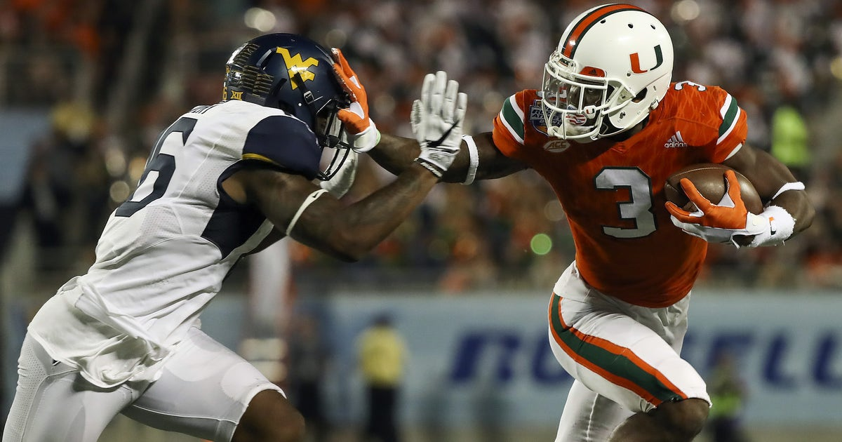 9772983-ncaa-football-russell-athletic-bowl-west-virginia-vs-miami.vresize.1200.630.high.0