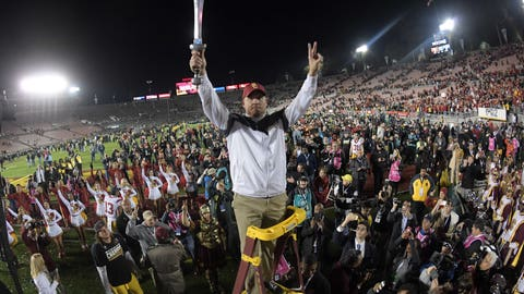 Jan 2, 2017; Pasadena, CA, USA; USC Trojans coach Clay Helton celebrates with the Spirit of Troy marching band after the 103rd Rose Bowl against the Penn State Nittany Lions at Rose Bowl. USC defeated Penn State 52-49 in the highest scoring game in Rose Bowl history. Mandatory Credit: Kirby Lee-USA TODAY Sports