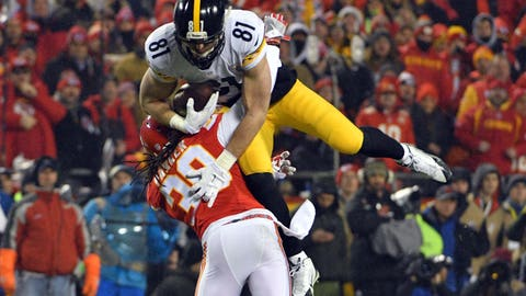 Jan 15, 2017; Kansas City, MO, USA; Pittsburgh Steelers tight end Jesse James (81) is upended by Kansas City Chiefs free safety Ron Parker (38) during the first quarter in the AFC Divisional playoff game at Arrowhead Stadium. Mandatory Credit: Denny Medley-USA TODAY Sports