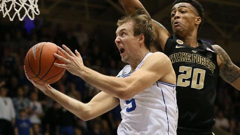 Feb 18, 2017; Durham, NC, USA; Duke Blue Devils guard Luke Kennard (5) drives to the basket past Wake Forest Demon Deacons forward John Collins (20) in the second half at Cameron Indoor Stadium. Mandatory Credit: Mark Dolejs-USA TODAY Sports