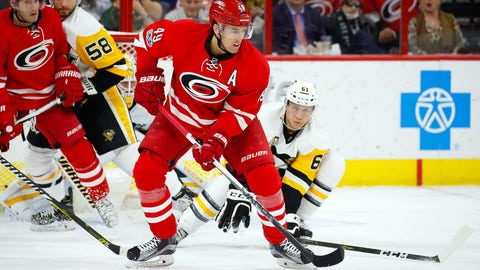 Feb 21, 2017; Raleigh, NC, USA; Carolina Hurricanes forward Victor Rask (49) controls the puck against Pittsburgh Penguins defensemen Steven Oleksy (61) during the second period at PNC Arena. Mandatory Credit: James Guillory-USA TODAY Sports
