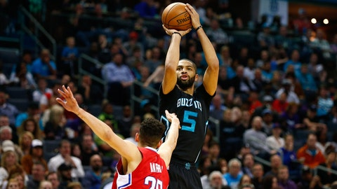 Feb 11, 2017; Charlotte, NC, USA; Charlotte Hornets guard Nicolas Batum (5) shoots the ball over LA Clippers guard Austin Rivers (25) in the second half at Spectrum Center. The Clippers defeated the Hornets 107-102. Mandatory Credit: Jeremy Brevard-USA TODAY Sports