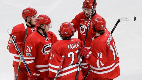 Carolina Hurricanes' Sebastian Aho (20), of Finland, celebrates his goal against the Edmonton Oilers with teammates Teuvo Teravainen, left, of Finland, Justin Faulk (27), Jordan Staal (11) and Elias Lindholm (16), of Sweden, during the third period of an NHL hockey game in Raleigh, N.C., Friday, Feb. 3, 2017. Carolina won 2-1. (AP Photo/Gerry Broome)