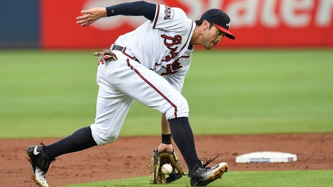 Aug 16, 2016; Atlanta, GA, USA; Atlanta Braves shortstop Chase d'Arnaud (23) fields a ground ball against the Minnesota Twins during the second inning at Turner Field. Mandatory Credit: Dale Zanine-USA TODAY Sports