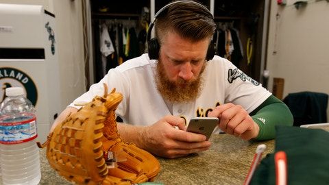 OAKLAND, CA - JUNE 1: Sean Doolittle #62 of the Oakland Athletics checks his iPhone in the clubhouse prior to the game against the Minnesota Twins at the Oakland Coliseum on June 1, 2016 in Oakland, California. The Athletics defeated the Twins 5-1. (Photo by Michael Zagaris/Oakland Athletics/Getty Images)
