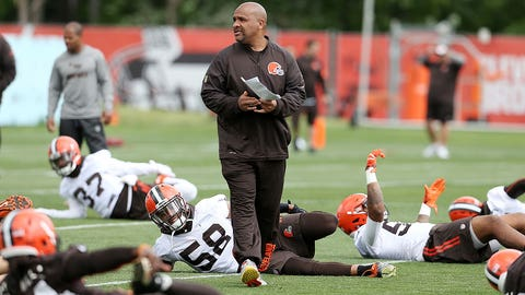 Cleveland Browns head coach Hue Jackson watches warm ups during NFL football mini camp at the practice facility Tuesday, June 7, 2016, in Berea, Ohio. (AP Photo/Ron Schwane)