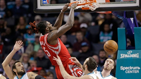 Houston Rockets' Montrezl Harrell (5) dunks against Charlotte Hornets' Frank Kaminsky III (44), Marco Belinelli (21) and Miles Plumlee (18) during the first half of an NBA basketball game in Charlotte, N.C., Thursday, Feb. 9, 2017. (AP Photo/Chuck Burton)