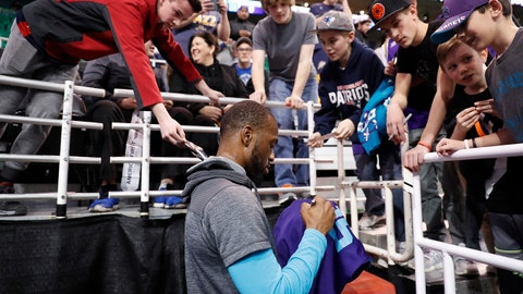 Feb 4, 2017; Salt Lake City, UT, USA;  Charlotte Hornets guard Kemba Walker (15) signs autographs for fans prior to their game against the Utah Jazz at Vivint Smart Home Arena. Mandatory Credit: Jeff Swinger-USA TODAY Sports