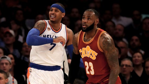 NEW YORK, NY - DECEMBER 07:  Carmelo Anthony #7 of the New York Knicks and LeBron James #23 of the Cleveland Cavaliers fight for position in the first quarter at Madison Square Garden on December 7, 2016 in New York City. NOTE TO USER: User expressly acknowledges and agrees that, by downloading and or using this Photograph, user is consenting to the terms and conditions of the Getty Images License Agreement  (Photo by Elsa/Getty Images)