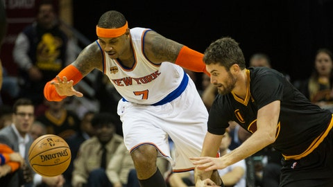 New York Knicks' Carmelo Anthony (7) beats Cleveland Cavaliers' Kevin Love to the ball during the second half of an NBA basketball game in Cleveland, Tuesday, Oct. 25, 2016. (AP Photo/Phil Long)