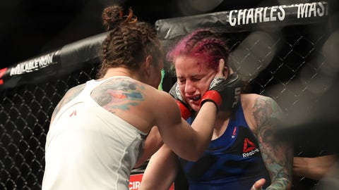 Feb 19, 2017; Halifax, NS, Canada; Sara McMann (red gloves) reacts with Gina Mazany (blue gloves) after their fight during UFC Fight Night at Scotiabank Centre. Mandatory Credit: Tom Szczerbowski-USA TODAY Sports