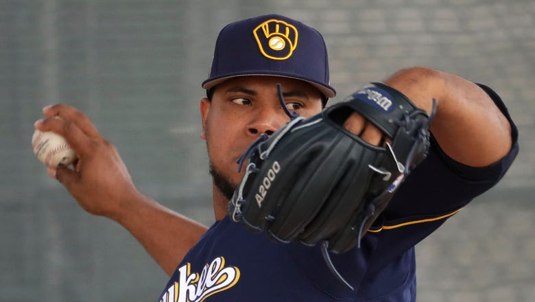 Brewers' Peralta pitches 5 2/3 scoreless innings in loss