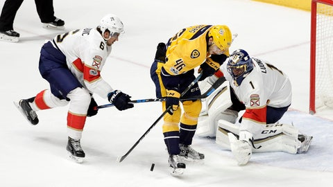 Nashville Predators left wing Pontus Aberg (46), of Sweden, is slowed down by Florida Panthers defenseman Alex Petrovic (6) and goalie Roberto Luongo (1) during the third period of an NHL hockey game Saturday, Feb. 11, 2017, in Nashville, Tenn. The Panthers won 7-4. (AP Photo/Mark Humphrey)