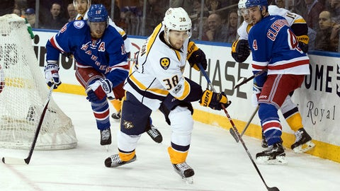 Nashville Predators left wing Viktor Arvidsson (38) controls the puck against as he skates past New York Rangers defenseman Marc Staal (18) during the first period of an NHL hockey game, Thursday, Feb. 9, 2017, at Madison Square Garden in New York. (AP Photo/Mary Altaffer)