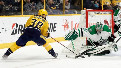 Dallas Stars goalie Kari Lehtonen (32), of Finland, blocks a shot by Nashville Predators left wing Viktor Arvidsson (38), of Sweden, during the second period of an NHL hockey game Sunday, Feb. 12, 2017, in Nashville, Tenn. (AP Photo/Mark Humphrey)