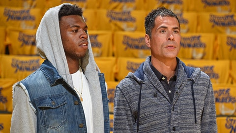 OAKLAND, CA - MAY 30: Basketball player Buddy Hield and agent Rob Pelinka watches the game between the Golden State Warriors and the Oklahoma City Thunder during Game Seven of the Western Conference Finals during the 2016 NBA Playoffs on May 30, 2016 at ORACLE Arena in Oakland, California. NOTE TO USER: User expressly acknowledges and agrees that, by downloading and or using this Photograph, user is consenting to the terms and conditions of the Getty Images License Agreement. Mandatory Copyright Notice: Copyright 2016 NBAE (Photo by Andrew Bernstein/NBAE via Getty Images)