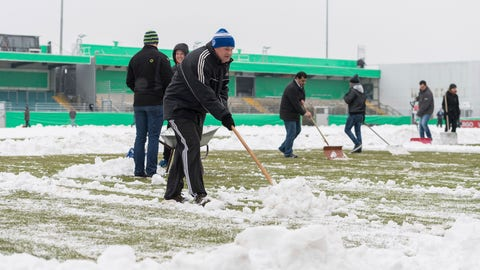 Fans and helpers have followed the call for help, freeing the pitch from snow before the DFB'Cup match between SF Lotte and TSV 1860 Munich at the FRIMO Stadium in Lotte, Germany, 8 February 2017. Photo by: Guido Kirchner/picture-alliance/dpa/AP Images