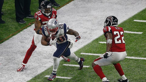 HOUSTON, TX - FEBRUARY 05: James White #28 of the New England Patriots carries the ball against the Atlanta Falcons during the fourth quarter during Super Bowl 51 at NRG Stadium on February 5, 2017 in Houston, Texas. The New England Patriots defeated the Atlanta Falcons 34-28.  (Photo by Bob Levey/Getty Images)