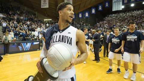 Feb 25, 2017; Villanova, PA, USA; Villanova Wildcats guard Josh Hart (3) carries the Big East regular season trophy onto the court after defeating the Creighton Bluejays at The Pavilion. The Villanova Wildcats won 79-63.Mandatory Credit: Bill Streicher-USA TODAY Sports