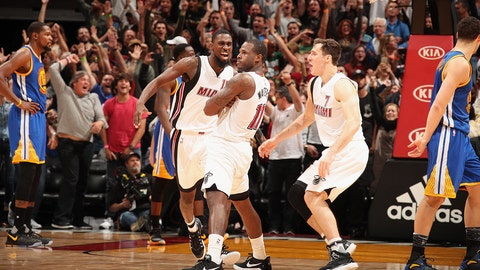 MIAMI, FL - JANUARY 23: Dion Waiters #11 of the Miami Heat celebrates with his team after making the game winning shot during the game against the Golden State Warriors on January 23, 2017 at American Airlines Arena in Miami, Florida. NOTE TO USER: User expressly acknowledges and agrees that, by downloading and or using this Photograph, user is consenting to the terms and conditions of the Getty Images License Agreement. Mandatory Copyright Notice: Copyright 2017 NBAE (Photo by Issac Baldizon/NBAE via Getty Images)