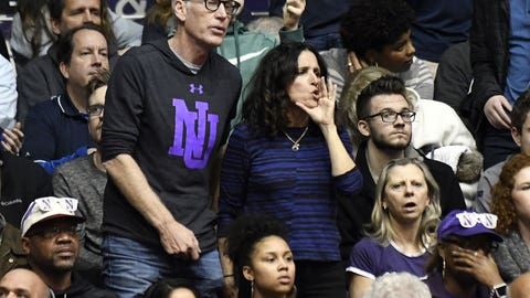Mar 1, 2017; Evanston, IL, USA; Movie actors Brad Hall and Julia Louis-Dreyfus (center) watch the game between the Northwestern Wildcats and the Michigan Wolverines during the second half at Welsh-Ryan Arena. Their son Charlie Hall plays for Northwestern. Northwestern won 67-65. Mandatory Credit: David Banks-USA TODAY Sports