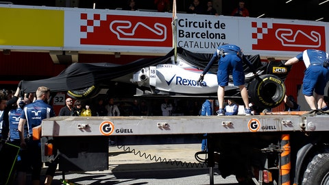 Lance Stroll's car is brought back to the garage after spinning on track during a Formula One preseason test at the Catalunya racetrack in Montmelo, Spain. (AP Photo/Francisco Seco)