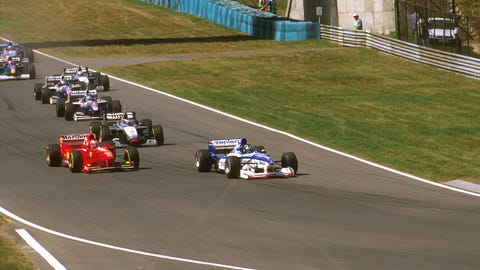 Damon Hill leads a pack of cars during the 1997 Hungarian GP. (Photo: LAT Photographic)