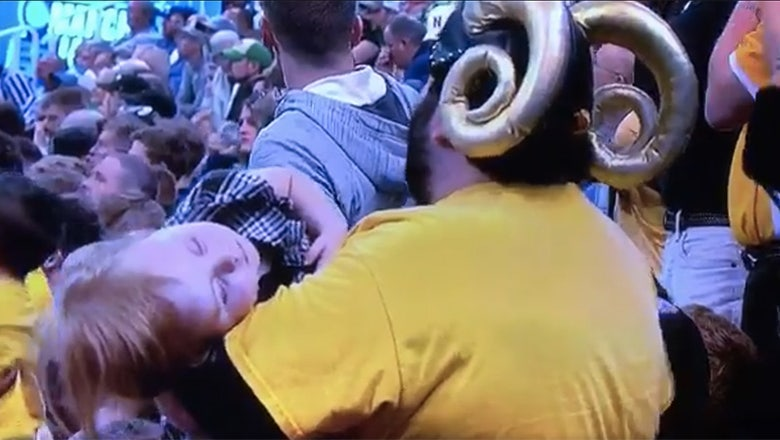 Good VCU fan cradles sleeping child while still enjoying the NCAA tournament