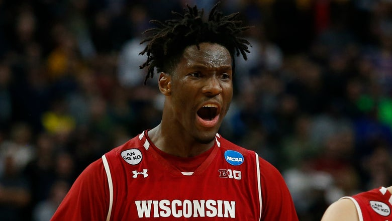 Wisconsin stuns Villanova to eliminate the No. 1 overall seed and defending champ