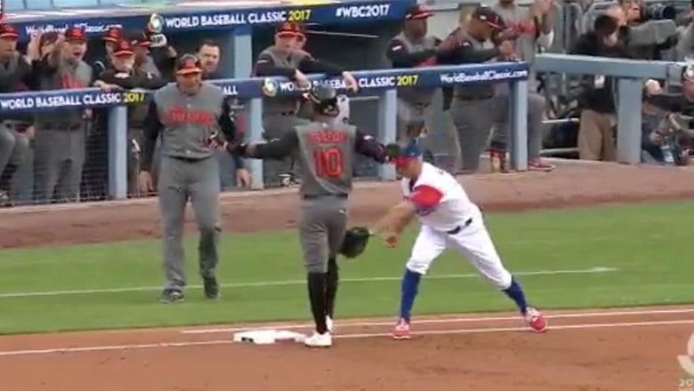 Yadier Molina picks off Jurickson Profar as he celebrates a first-inning single