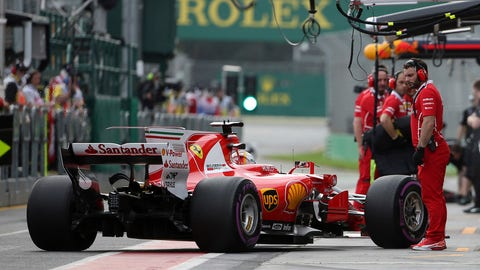 Sebastian Vettel steers his car into the pits during practice for the Australian GP. (AP Photo/Rick Rycroft)