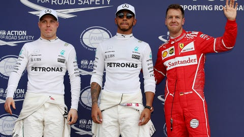 Lewis Hamilton (C), Sebastian Vettel (R), and Valtteri Bottas (L) will start 1st, 2nd and 3rd respectively for the Australian GP.  (AP Photo/Rick Rycroft)